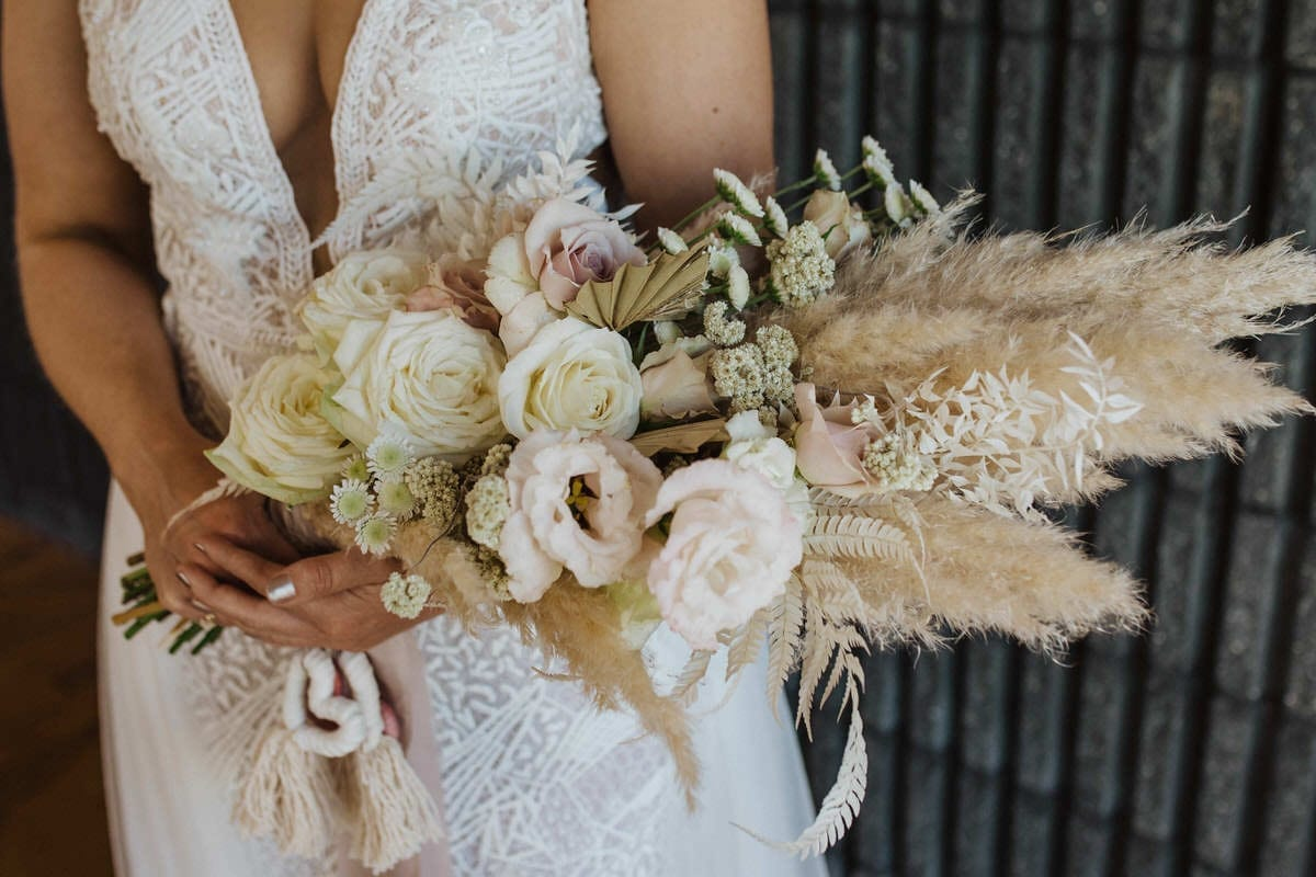 The Stem-ery Wild Hearts Wedding Vendor Directory - creating unique bespoke relaxed and unstructured designs, in a sustainable way - bride holding beautiful bouquet