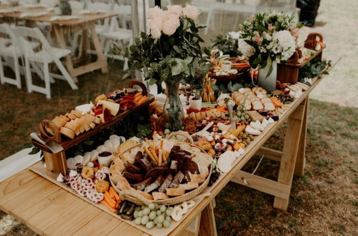 Grazy Wild Hearts Wedding Vendor Directory - Beautiful Grazing Tables and Platters creating stunning tablescapes that are put together with high quality produce that will make a real statement - platters on trestle table